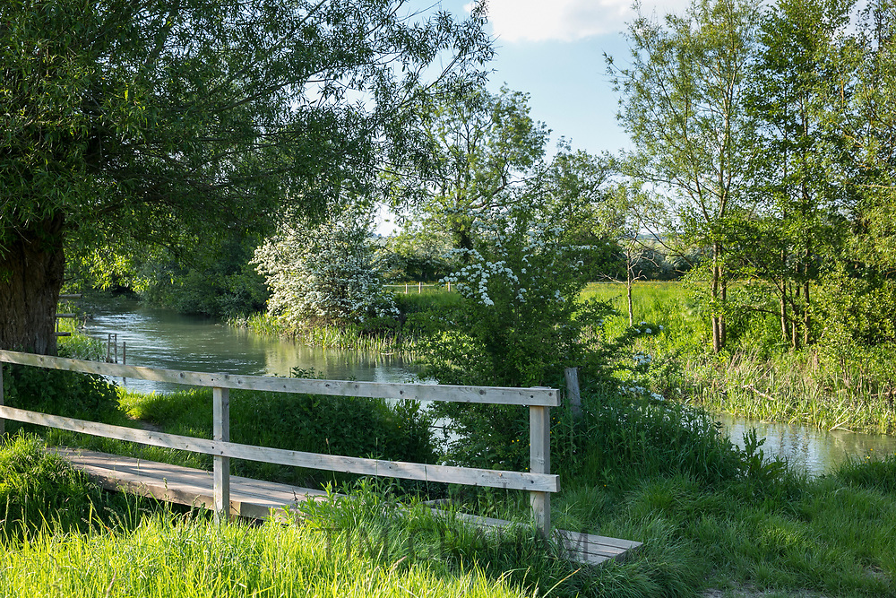 Footbridge and The River Windrush in late Spring / early Summer at Burford in the Oxfordshire Cotswolds, UK