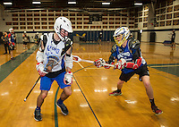 Kris Shepard and Seth Valpey work on drills with the Lacrosse team in the Gilford High School gym on Friday afternoon.  (Karen Bobotas/for the Laconia Daily Sun)