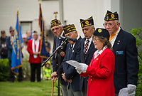 Brenda Chamberlain addresses the crowd with the American Legion Post 1 during the Memorial Day service at Veteran's Square in Laconia Monday morning.  (Karen Bobotas/for the Laconia Daily Sun)