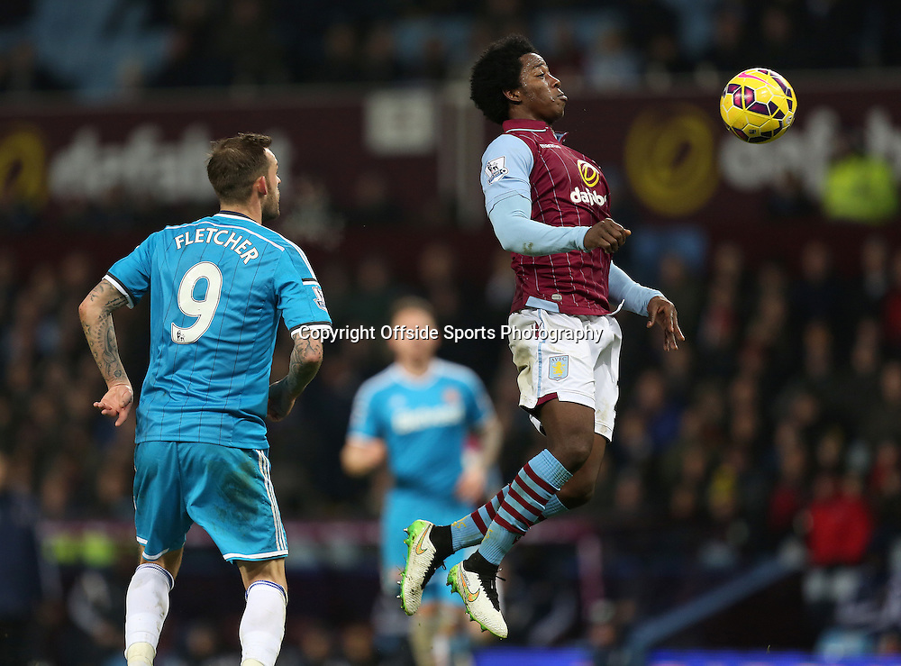 28th December 2014 - Barclays Premier League - Aston Villa v Sunderland - Carlos Sanchez of Aston Villa chests the ball under pressure - Photo: Paul Roberts / Offside.