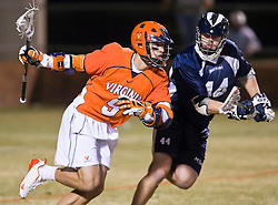 Virginia Cavaliers A Danny Glading (9) takes on Mt. Saint Mary's M Ryan Shewell (14).  The #2 ranked Virginia Cavaliers defeated the Mt. Saint Mary's Mount 10-2 at the University of Virginia's Klockner Stadium in Charlottesville, VA on February 24, 2009.   (Special to the Daily Progress / Jason O. Watson)
