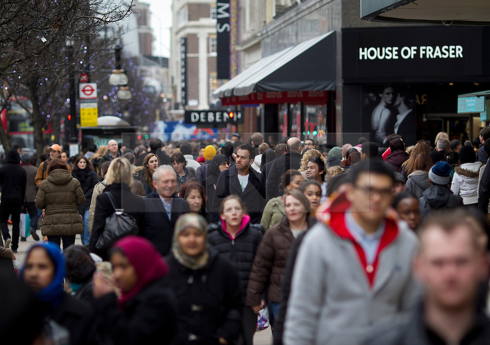 © Licensed to London News Pictures. 26/12/2012. London, UK. Thousands of shoppers are seen taking advantage of boxing day sales on Oxford Street in London today (26/12/12). Photo credit: Matt Cetti-Roberts/LNP