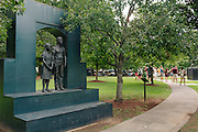 A statue of children in a jail is seen alongside a tour group in Kelly Ingram Park in downtown Birmingham August 13, 2013. On May 2, 1963 more than 1,000 students marched downtown and more than 600 were jailed. The park has several art installations that coincide with the Birmingham Civil Rights Institute and the 16th Street Baptist Church, which sit across the street.