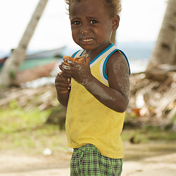 Papua kid having blond curly hair
