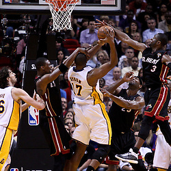 March 10, 2011; Miami, FL, USA; Miami Heat power forward Chris Bosh (1) fouls Los Angeles Lakers center Andrew Bynum (17) during the third quarter at the American Airlines Arena. The Heat defeated the Lakers 94-88.   Mandatory Credit: Derick E. Hingle