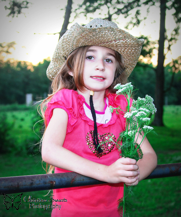 Little Cowgirl With Wild Flowers, image for sale