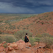 Girl climbing Kings Canyon in Northern Territories. Girl walking on the top of the Kings Canyon