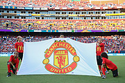 Manchester United flag held by young MacDonalds sponsors during the International Champions Cup match between Barcelona and Manchester United at FedEx Field, Landover, United States on 26 July 2017.