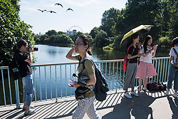 © Licensed to London News Pictures. 23/07/2018. London, UK. People enjoy the early morning sun in St James's Park central London, as the hot weather continues in the capital. Forecasters are predicting record temperatures this week. Photo credit: Ben Cawthra/LNP