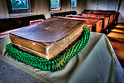 A bible and lei in the Kealii O Ka Malu Church in Hale'iwa on the North Shore of Oahu.