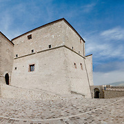 The fort of San Leo also known as the fortress of San Leo is in the eponymous town in the province of Rimini. It is situated on top of the rocky spire that overlooks the city and dominates the Valmarecchia