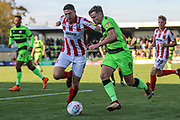 Forest Green Rovers Dayle Grubb(8) takes on Cheltenham Town's Ben Tozer(4) during the EFL Sky Bet League 2 match between Forest Green Rovers and Cheltenham Town at the New Lawn, Forest Green, United Kingdom on 20 October 2018.