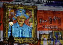 © Licensed to London News Pictures. 19/04/2012. London, UK .Over 200,000 self portraits by children from across the UK are projected onto the frontage of Buckingham Palace to form a montage image of Her Majesty Queen Elizabeth II. Face Britain is a unique project created by The Prince's Foundation for Children and the Arts and educational charity established by the Prince of Wales. The event runs every night between 2030 and 2330 until 21st April. Photo credit : Stephen Simpson/LNP