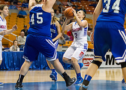 Morgantown guard Sammie Parks (3) drives down the lane and puts a shot over Buckhannon Upshur center Megan Wilfong (45) during a first round game at the Charleston Civic Center.