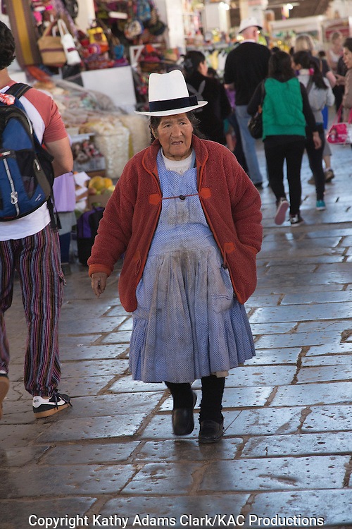 Lady working in the market in Cusco, Peru. Hat denotes village or region.