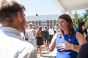 New students meet an alumna after the College of Business Freshman Convocation outside of Nelson Commons, on Saturday, August 22, 2015. Photo by Kaitlin Owens
