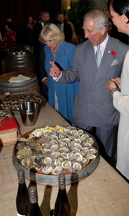 Prince Charles, Prince of Wales and Camilla, Duchess of Cornwall sample oysters during their tour of the Mahana winery near Nelson, New Zealand, Saturday, November 07, 2015. SNPA / Reuters, Anthony Phelps **POOL**