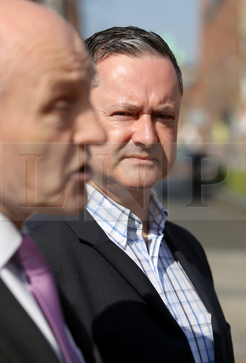 "© Licensed to London News Pictures. 9/05/2016. Belfast, Northern Ireland, UK. Gay rights activist Gareth Lee listens to  Dr Michael Wardlow, Chief Commissioner for the Equality Commission for Northern Ireland, outside the Belfast High Court before the start Appeal hearing over gay marriage cake row with Ashers Baking Company. The legal appeal by Ashers Baking Company in the controversial 'gay cake' case is to be heard over two days. In May last year a judge at Belfast County Court ruled that the bakery had acted unlawfully. The court ordered Ashers to pay £500 damages after Judge Isobel Brownlie said the customer had been treated ""less favourably"" contrary to the law and the bakery had breached political and sexual orientation discrimination regulations. But the McArthur family who own and run Ashers decided to challenge the ruling following consultations with their legal advisors. The family has been given the full support of The Christian Institute, which has funded their defence costs. The legal case followed a decision in May 2014 by Ashers to decline an order placed at its Belfast store by a gay rights activist who asked for a cake featuring the Sesame Street puppets, Bert and Ernie, and the campaign slogan, 'Support Gay Marriage'. The customer also wanted the cake to feature the logo of a Belfast-based campaign group QueerSpace. Ashers, owned by Colin and Karen McArthur, refused to make the cake because it carried a message contrary to the family's firmly-held Christian beliefs. They were supported by their son Daniel, the General Manager of the company. But the Equality Commission for Northern Ireland (ECNI) launched a civil action against the family-run bakery, claiming its actions violated equality laws in Northern Ireland and alleging discrimination under two anti-discrimination statutes – The Equality Act (Sexual Orientation) Regulations (NI) 2006 and The Fair Employment and Treatment (NI) Order 1998. Photo credit : Paul McErlane/LNP"