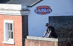 © Licensed to London News Pictures. 19/05/2018. London, UK. Police watch from a rooftop ahead of The wedding of Prince Harry to Meghan Markle at St George's Chapel in Windsor. Photo credit: Ben Cawthra/LNP