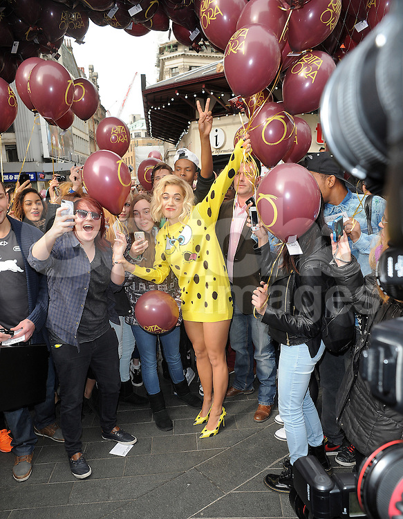 Singer Rita Ora wearing a SpongeBob SquarePants dress visits Radio 1 and releases balloons in Leicester Square to mark her new single 'I Will Never Let You Down'. London, UK. 31/03/2014<br />
