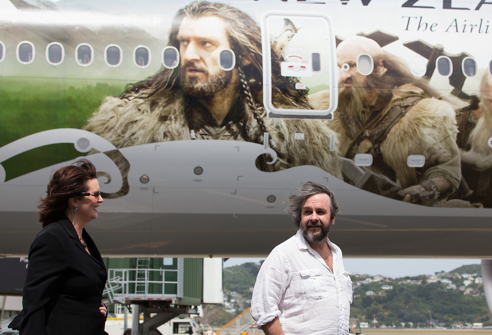 Hobbit director Sir Peter Jackson, right and screenwriter Philippa Boyens, after a photo call with fellow actors and Air New Zealand's Boeing 777-300ER aircraft at Wellington Internatonal Airport for Wednesday's premiere of the Hobbit movie, Wellington, New Zealand, Tuesday, November 27 , 2012. Credit: SNPA / Stephen Barker.