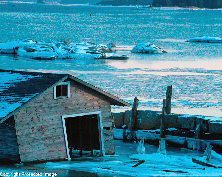 A waterman's shack surrounded by ice in the early morning light