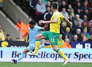 Picture by Andrew Timms/Focus Images Ltd. 07917 236526.14/04/12.Carlos Tevez of Manchester City scoring his side's first goal during the Barclays Premier League match against Norwich City at Carrow Road stadium, Norwich.