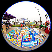 Venice Boardwalk  ?  Vendor selling paintings near Rose Ave  ?  weekend