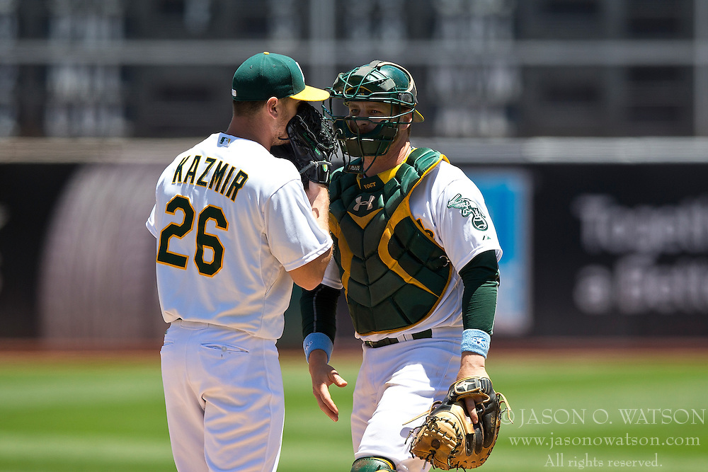 OAKLAND, CA - JUNE 21:  Scott Kazmir #26 of the Oakland Athletics talks to Stephen Vogt #21 during the first inning against the Los Angeles Angels of Anaheim at O.co Coliseum on June 21, 2015 in Oakland, California. (Photo by Jason O. Watson/Getty Images) *** Local Caption *** Scott Kazmir; Stephen Vogt
