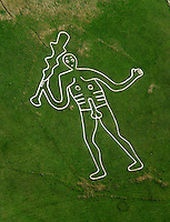 The Cerne Abbas Giant is a hill figure near the village of Cerne Abbas in Dorset, England. Made by a turf-cut outline filled with chalk, it depicts a large, naked man, typically described as a giant, wielding a club. - en.wikipedia.org/wiki/Cerne_Abbas_Giant
