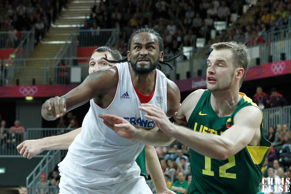 02 August 2012: France Ronny Turiaf vies for the rebound with Lithuania Antanas Kavaliauskas during 82-74 Team France victory over Team Lithuania, during the men's basketball preliminary, at the Basketball Arena, in London, Great Britain.