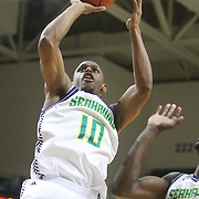 UNCW's Freddie Jackson shoots against Liberty Wednesday December 17, 2014 at Trask Coliseum on the campus of UNCW in Wilmington, N.C. (Jason A. Frizzelle)