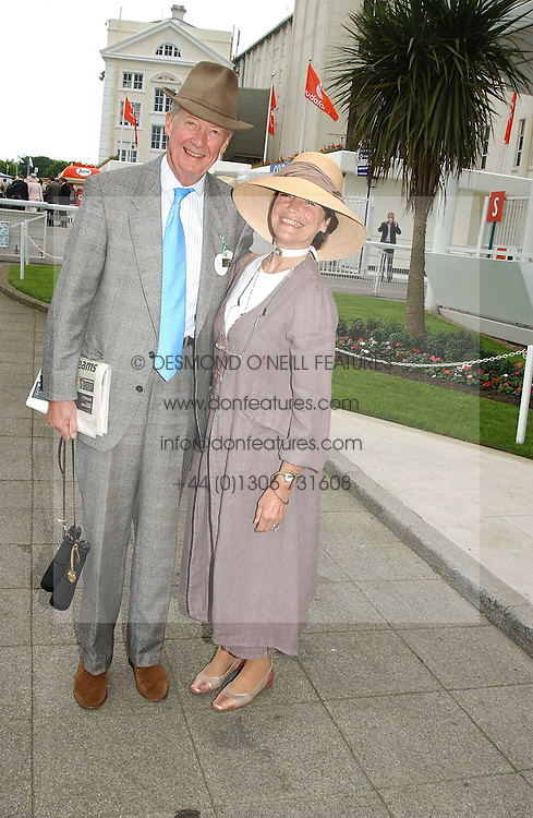 VISCOUNT & VISCOUNTESS MARCHWOOD at Ladies Day at Epsom Racecourse, Surrey during the Derby Festival on 3rd June 2005.<br />