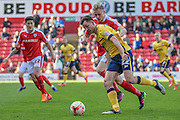 Tom Hopper (Scunthorpe United) shields the ball during the Sky Bet League 1 match between Barnsley and Scunthorpe United at Oakwell, Barnsley, England on 25 March 2016. Photo by Mark P Doherty.