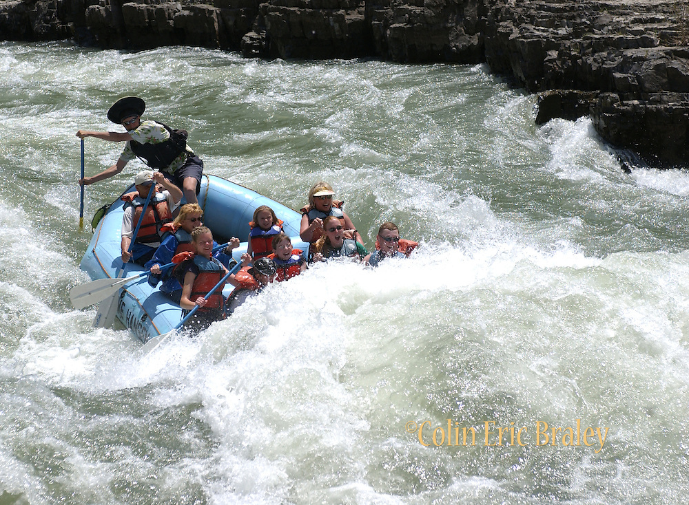 "Rafters make their way through the ""Lunch Counter"" rapids on the Snake River in Wyoming. Several commercial river running companies, based near Jackson, Wyoming, make running the Snake River accessible for thousands of adventure seekers each season."