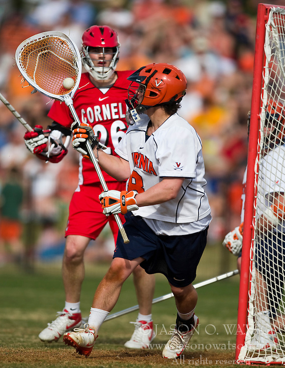 Virginia Cavaliers G Adam Ghitelman (8) makes a save in front of Cornell Big Red A Ryan Hurley (26).  The #1 ranked Virginia Cavaliers defeated the #4 ranked Cornell Big Red 14-10 at Klockner Stadium on the Grounds of the University of Virginia in Charlottesville, VA on March 8, 2009.
