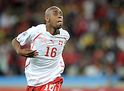 Gelson Fernandes of Switzerland celebrates scoring the first goal during the 2010 FIFA World Cup South Africa Group H match between Spain and Switzerland at Durban Stadium on June 16, 2010 in Durban, South Africa.