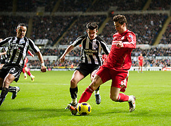 NEWCASTLE, ENGLAND - Saturday, December 11, 2010: Liverpool's Fernando Torres and Newcastle United's Joey Barton during the Premiership match at St James' Park. (Photo by: David Rawcliffe/Propaganda)