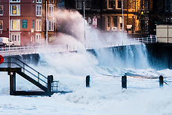 © Licensed to London News Pictures. 13/01/2017. Aberystwyth, Wales, UK. At first light, and with the 5.3m high tide, gale force winds bring monstrous waves crashing against the seafront in Aberystwyth on the Cardigan Bay coast of west Wales .  Photo credit: Keith Morris/LNP