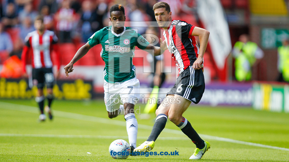 Florian Jozefzoon of Brentford and Chris Basham of Sheffield United during the Sky Bet Championship match between Sheffield United and Brentford at Bramall Lane, Sheffield<br /> Picture by Mark D Fuller/Focus Images Ltd +44 7774 216216<br /> 05/08/2017