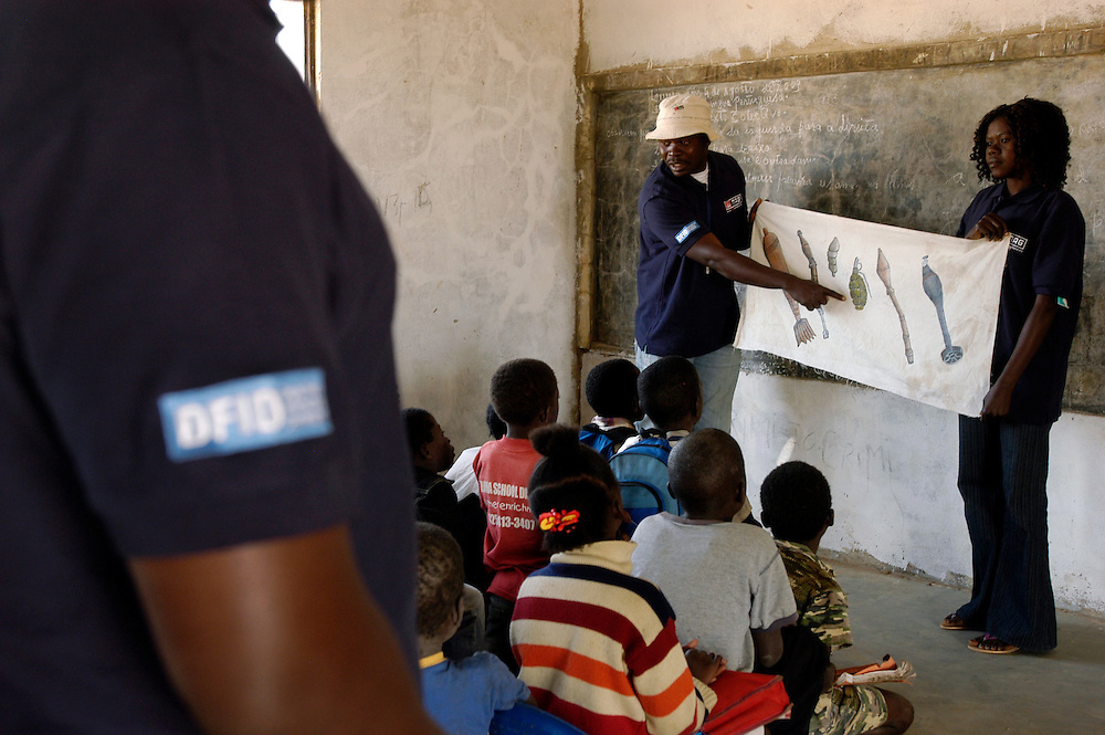 Romeu Canguia and a community liaison team from Mines Advisory Group (MAG) give a mine risk education session in a school in 4 de Fevereiro, an area that was cleared of landmines and unexploded ordinance by MAG to allow the resettlement of refugees returning to Moxico province after three decades civil war..Luena, Angola. 04/08/2009..Photo © J.B. Russell