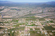 In the foreground, the standard grid of quarter-mile sections is stamped onto the Phoenix landscape.  In the background is Anthem, a master planned suburban community in an as yet unincorporated area 34 miles north of downtown Phoenix.  Since Anthem opened in 1998, its population has grown to 40,000.