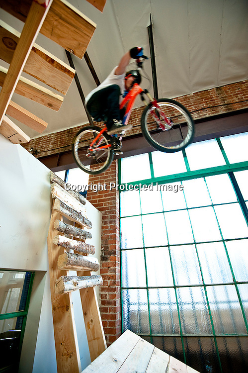 Kyle Strait table tops over a wall on set at Fuel TV's Built To Shred