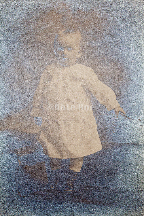 silver oxidizing vintage studio portrait of a little child