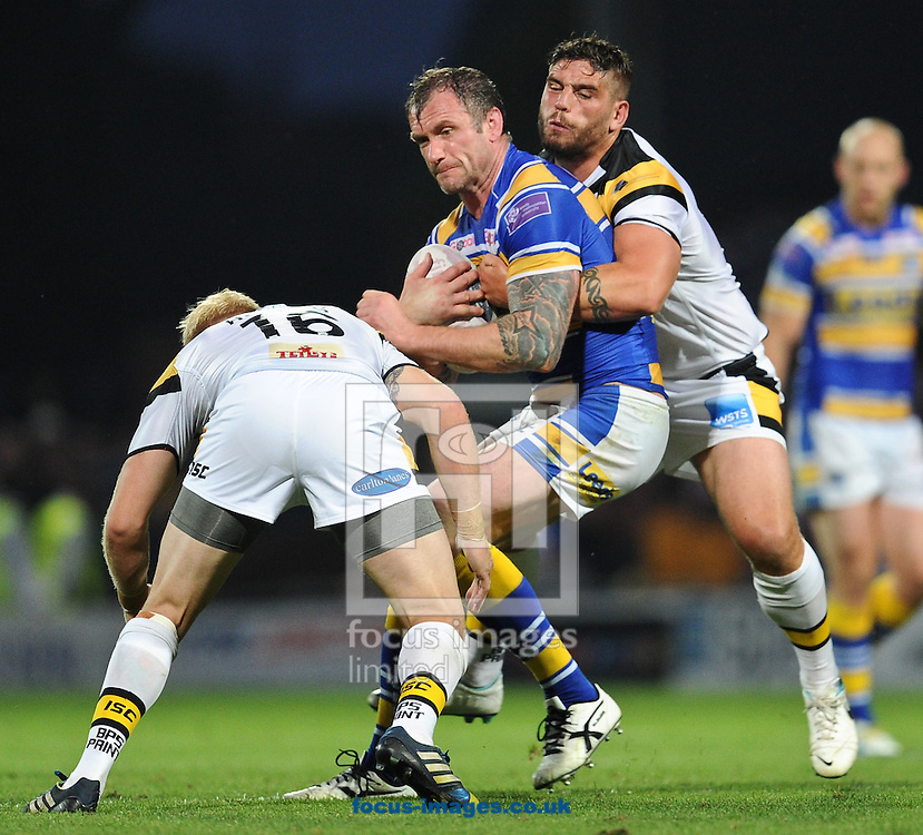 Jamie Peacock of Leeds Rhinos is stopped by Lee Jewitt (R) &amp; Oliver Holmes (L) of Castleford Tigers during the First Utility Super League match at Headingley Carnegie Stadium, Leeds<br /> Picture by Richard Land/Focus Images Ltd +44 7713 507003<br /> 17/07/2014