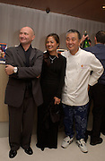Phil Collins, Cevey Collins and Nobu San, Nobu and Garrard in aid of Save the Children, Nobu, 12 March 2003. © Copyright Photograph by Dafydd Jones 66 Stockwell Park Rd. London SW9 0DA Tel 020 7733 0108 www.dafjones.com