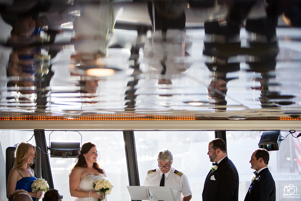 Elizabeth and Ryan celebrate their wedding with family and friends on the Commodore Chardonnay yacht during a tour around the San Francisco Bay in San Francisco, California, on October 5, 2013.  (Stan Olszewski/SOSKIphoto for Benjamin Photographics)