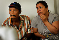 NEW ORLEANS, LA- June 22:  (L-R)  Waiting for their turn to receive assistance, Dung Nguyen with his wife, Ut, have spent at least 5 hours on line... .Vietnamese affected by the Gulf oil spill because of their work in the fishing industry, wait on an early morning line at Mary Queen of Vietnam Catholic Church to receive financial assistance from Catholic Community Services, in New Orleans, Louisiana, Tuesday June 22, 2010.  (Melina Mara/The Washington Post)