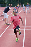 Middletown, New York - Children compete in a race during the Twilight Track and Field Series run by the Middletown High School Varsity track program on July 22, 2014.