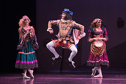 © Licensed to London News Pictures. 18/09/2015. London, UK. Boris Nowitsky (Carlos Renedo) as Count with Varvara Bractchikova (Giovanni Goffredo) and Eugenia Repelskii (Joshua Thake) as Gypsies. Les Ballets Trockadero de Monte Carlo (The Trocks) perform the UK premiere of Don Quixote during a photocall at the Peacock Theatre. With Yakaterina Verbosovich (Chase Johnsey) as Kitri, PVyacheslav Legupski (Paolo Cervellera) as Basil, Olga Supphozova (Robert Carter) as Amour, Lariska Dumbcheno (Raffaele Morra) as Mother, Boris Nowitsky (Carlos Renedo) as Count and Varvara Bractchikova (Giovanni Goffredo) and Eugenia Repelskii (Joshua Thake) as Gypsies. Photo credit: Bettina Strenske/LNP